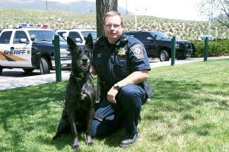 Kyle Hall with his Eagle County Sheriff's Office K-9 partner.