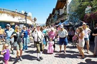 Oktoberfest attendees dance with Helmut Fricker in Vail Village during last year's Oktoberfest celebrations. This weekend the annual event takes place in Lionshead.