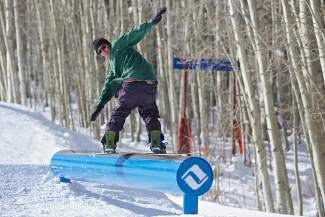 Dom Loconte is seen styling out a frontside board slide in the Vail Mountain park on Friday.