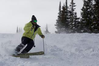 Matt Burton cuts up chunky snow on South Look Ma in Vail on Friday.