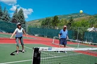 Kathy Kimmel and John Gottlieb, both of Vail, enjoy a game of pickleball earlier this year at Golden Peak in Vail. The Vail Town Council recently approved a $1 million plan that will put six new courts at the site in 2016.