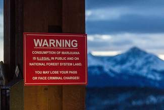 A sign posted at the top of Vail's Eagle Bahn Gondola in Lionshead informs skiers that legal marijuana may not be used in public places or on federal lands.