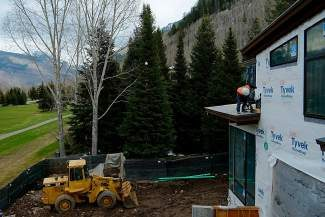 A construction worker nails a support in place on a roof of a house contracted by R.A. Nelson in Vail on Thursday. Construction in Vail is on the rise, while numbers from the first quarter of this year's real estate market point toward a sustained recovery.