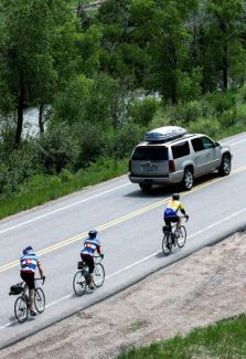A motorist shares the road with cyclists as they travel from Steamboat Springs to Avon along Highway 6 on their 471 mile journey of the Ride the Rockies bicycle tour Wednesday near Edwards.
