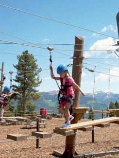 The new kids ropes course on Vail Mountain features six distinct obstacle areas including rope bridges, suspended wood bridges, swinging logs, and other balance elements.