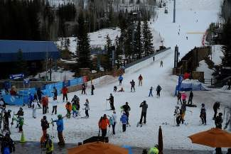 Skiers and snowboarders make their way to the Eagle Bahn Gondola on Vail Mountain on Friday. Despite heavy snow melt over the past few days, thousands were still venturing down Vail's slopes.