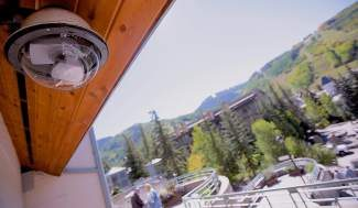 A surveillance camera looks out over the Vail in-town bus stops and Covered Bridge area Tuesday in Vail Village. The town of Vail is planning on installing more surveillance cameras at various locations throughout the town.