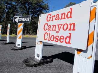 FILE - This Oct. 3, 2013 file photo shows a sign at the south entrance to Grand Canyon National Park, Ariz., indicates the park is closed. The Obama administration says it will allow states to use their own money to reopen some national parks that have been closed because of the government shutdown. Governors in at least four states have asked for authority to reopen national parks within their borders because of the economic impacts caused by the park closures.   (AP Photo/Brian Skoloff, File)