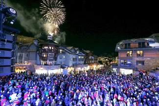 Fireworks explode during the opening ceremony for the FIS Alpine World Ski Championships, Monday, Feb. 2, 2015, in Vail, Colo. (AP Photo/Brennan Linsley)