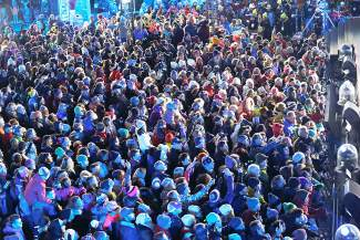 A crowd watches the opening ceremony for the FIS Alpine World Ski Championships Monday, Feb. 2, 2015, in Vail, Colo. (AP Photo/Brennan Linsley)