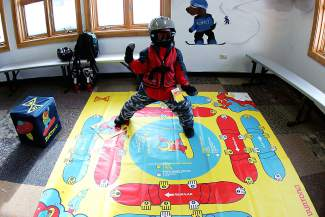 A young snowboarder plays around on the indoor training mat at Keyston'e Riglet Park. The new Burton-sponsored park introduces young snowboarders to techniques and other riding basics on flat terrain with kid-friendly equipment.