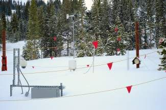 A camera is positioned at a specific level to be able to read the level of the snowpack on Vail Mountain. This SNOTEL (snow telemetry) site records snowpack levels and related data which is sent via solar-powered systems to the National Resources Conservation Service.