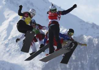 Czech Republic's Eva Samkova, second right, leads the field in the women's snowboard cross final at the Rosa Khutor Extreme Park, at the 2014 Winter Olympics, Sunday, Feb. 16, 2014, in Krasnaya Polyana, Russia. Samkova went on to win the gold medal. The other boarders are, from left, Bulgaria's Alexandra Jekova, Canada's Dominique Maltais, France's Chloe Trespeuch (obscured), and United States' Faye Gulini. (AP Photo/Luca Bruno)
