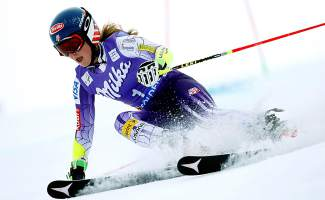 Mikaela Shiffrin speeds down the course on her way to win an alpine ski, women's World Cup giant slalom in Soelden, Austria, Saturday, Oct. 25, 2014. Anna Fenninger and Mikaela Shiffrin tied for the first place. (AP Photo/Shinichiro Tanaka)