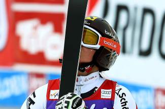 Austria's Anna Fenninger kisses her skis after winning an alpine ski, women's World Cup giant slalom in Soelden, Austria, Saturday, Oct. 25, 2014. Anna Fenninger and Mikaela Shiffrin tied for the first place. (AP Photo/Giovanni Auletta)
