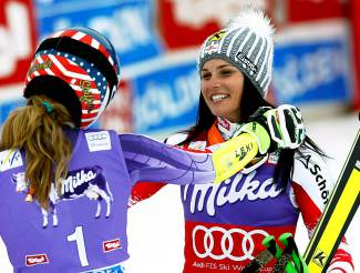 Mikaela Shiffrin, left, and Austria's Anna Fenninger celebrate in the finish area after they tied in the women's World Cup giant slalom in Soelden, Austria, in 2014.