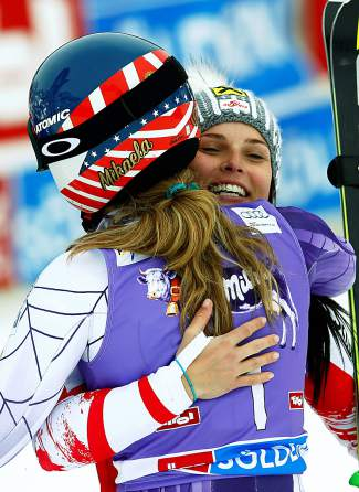 Mikaela Shiffrin, of the United States, left, and Austria's Anna Fenninger celebrate in the finish area after winning an alpine ski, women's World Cup giant slalom in Soelden, Austria, Saturday, Oct. 25, 2014. Shiffrin and Fenninger tied for the first place. (AP Photo/Alessandro Trovati)