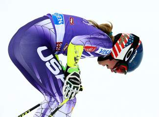 Mikaela Shiffrin, of the United States, celebrates in the finish area after winning an alpine ski, women's World Cup giant slalom in Soelden, Austria, Saturday, Oct. 25, 2014. Shiffrin tied for the first place with Austria's Anna Fenninger. (AP Photo/Giovanni Auletta)