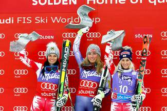 Mikaela Shiffrin, center, and Anna Fenninger, left, the winners, and third placed Eva-Maria Brem, celebrate on the podium of an alpine ski, women's World Cup giant slalom in Soelden, Austria, Saturday, Oct. 25, 2014. Anna Fenninger and Mikaela Shiffrin tied for the first place. (AP Photo/Giovanni Auletta)