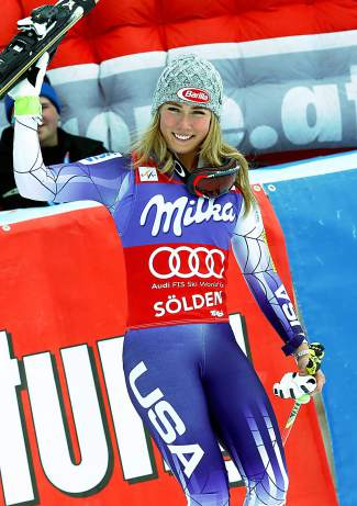Mikaela Shiffrin celebrates in the finish area after winning an alpine ski, women's World Cup giant slalom in Soelden, Austria, Saturday, Oct. 25, 2014. Anna Fenninger and Mikaela Shiffrin tied for the first place. (AP Photo/Giovanni Auletta)