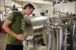 Max Vogelman surveys some of the distillery's custom equipment.