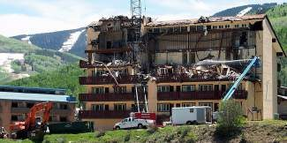 "Crews work to tear down the Lionshead Inn on Tuesday in Vail. The redevelopment project — approved as ""Strata,"" but soon to be re-named ""The Lion"" — is the biggest to start in town since the boom years in the last decade"