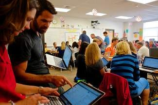 Samuel Bennet, a teacher at Vail Ski & Snowboard Academy, works with Michelle Morrison, a fifth grade teacher at Brush Creek Elementary, during the EdCamp event held at Battle Mountain High School on Thursday. EdCamp gave educators the chance to immerse themselves in different seminars to bring new teaching techniques to the classroom.