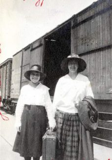 Hazel Tracy and Kate Flynn hold a suitcase between them at the Gypsum train depot after a dance in 1920.