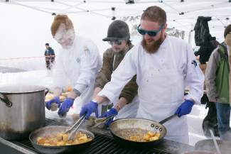 Executive chef Chris Moulton, right, prepares fresh cornbread for an onslaught of Colorado elk three bean chili coming down the assembly line from the Blu's restaurant team at the Taste of Vail Mountain Top Tasting at Eagle's Nest on Friday. Blu's elk chili proved to be a crowd favorite.