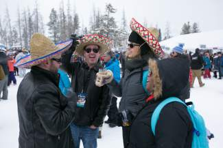 Valerie Woodbury, right, and Craig Green share a bottle of wine and a few laughs at the Taste of Vail Mountain Top Tasting in Vail on Friday.