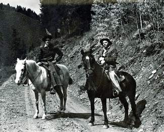 Cyrus Dice, right, and an unidentified man on horseback along Brush Creek. Dice ranched in the area for many years, moving to Eagle when he retired.