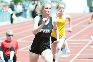 Eagle Valley's Carly Volkmer pours on the gas during the 400 finals during the state meet in Denver on Saturday. The junior finished fourth.