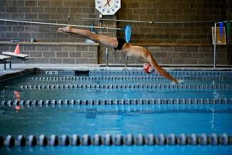Local triathlete John O'Neill dives into the pool while training at the Avon Recreation Center. O'Neill—a decorated NCAA Division-1 cross country runner in college—is relatively new on the triathlon scene. Standing 12th in the U.S., he will be competing in the next  International Triathlon Union World Cup event in the Sichuan Province of China on May 10.
