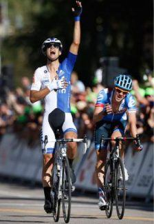 Kiel Reijnen, of team United Healthcare, celebrates as he wins the opening stage of the USA Pro Challenge bike race in a two-man sprint ahead of Alex Howes of team Garmin-Sharp, in Aspen, Colo. Monday Aug.18, 2014. (AP Photo/Brennan Linsley)