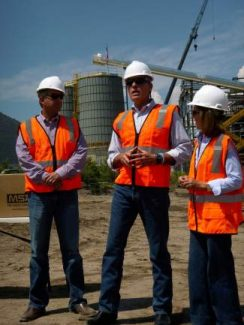 Dean Rostrom of Eagle Valley Clean Energy LLC, left, speaks with U.S. Sen. Mark Udall, center, and state Sen. Gail Schwartz about the biomass power plant being built in Gypsum. The plant is on schedule to start production in December.
