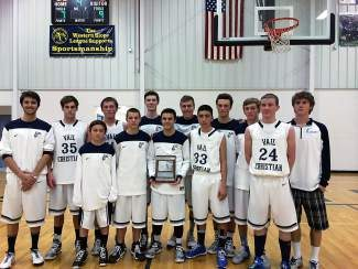 Vail Christian boys basketball gathers around the second-place plaque at the District 1 Tournament in Olathe on Saturday. Despite a loss to Norwood on Saturday in the title game, Vail Christian advanced to regionals and plays Primero next weekend in Gunnison with a spot in the state tournament on the line.