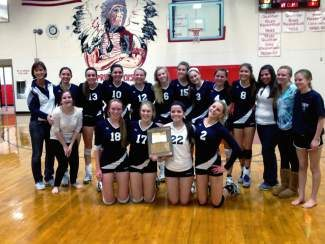 Vail Christian volleyball celebrates its berth in the state tournament after winning the Region A Tournament on Saturday in La Veta.