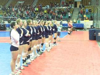 The Vail Christian volleyball team stands for the national anthem on Friday morning at the 1A state tournament at the Denver Coliseum. The Saints went out and defeated Kit Carson in three sets.