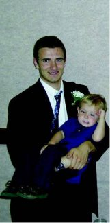 Special to the Daily  Joshua Jay holds his nephew Matt during a family celebration prior to his accident.