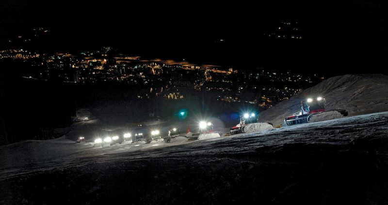 Snowcats at night | VailDaily com
