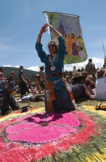 Peter M. Fredin/AP PhotoA Rainbow Family member performs a ritual preceding the prayer circle held in a meadow in the Routt National Forest.