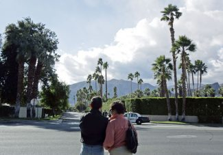 Kevork Djansezian/AP PhotoA couple look at the entrance of former  President Gerald Ford's  house at the end of Sand Dune Road in Rancho Mirage, Calif., Wednesday.
