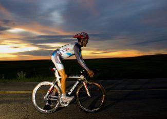 Special to the Daily/Mark Ridenour/www.mark-ridenoMike Janelle rides through the sunset in eastern Colorado Thursday.