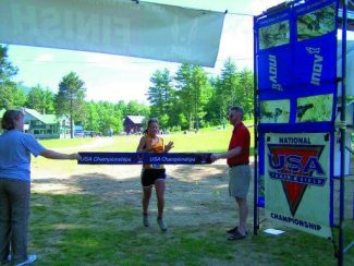 Special to the Daily Anita Ortiz crosses the finish line at the Cranmore HIll Climb, where she qualified for the USA Mountain Running Team.