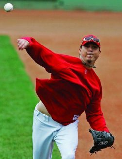 Boston Red Sox pitcher Josh Beckett throws a ball during practice Tuesday, Oct. 23, 2007, at Fenway Park in Boston. The Boston Red Sox host the Colorado Rockies in Game 1 of the baseball World Series Wednesday night. (AP Photo/Elise Amendola)
