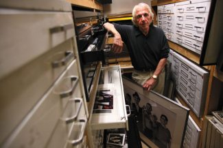 Jordan Curet/The Aspen Times WeeklyNorm Greshman stands amongst years of photographs that he has taken.