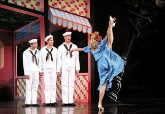 """Dominique Taylor/Vail DailyDancer Kari Brunson, right, flirts with sailors from left Jonathon Porretta, Josh Spell and Jeffrey Stanton during Pacific Nothwest Ballet's dress rehearsal of Jerome Robbins' """"Fancy Free Monday at the Ford Ampitheater in Vail."""