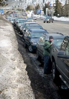Kristin Anderson/Vail DailyDue to the parking garges being full, vehicles fill up the frontage road Friday in Vail, Colorado.