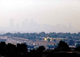AP/Ed AndrieskiDenver's downtown skyline was obscured on Tuesday because of smoke and haze from wildfires in California, Utah and Colorado