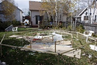 The framework used to launch a balloon stands in the backyard of the home of Richard and Mayumi Heene in Fort Collins,, Colo., Sunday, Oct. 18, 2009. The Heenes reported that their 6-year-old son, Falcon, was on board the balloon. Falcon was later found safe. The story that the child had floated away in a giant helium balloon was a hoax concocted to land a reality television show, authorities said, and the boy's parents will likely face felony charges. (AP Photo/David Zalubowski)